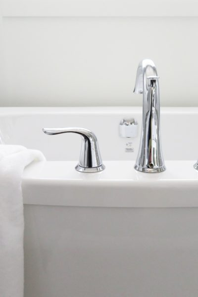 white bathtub and faucet