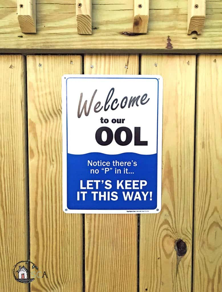 sign on a wood background - welcome to our ool